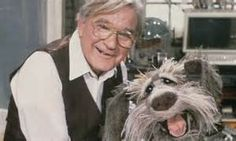 """Gerard Parkes -- (10/16/1924-10/19/2014). Irish-born Canadian Actor. He portrayed Doc on TV Series """"Fraggle Rock"""" Barton Winslow on """"Shining Time Station"""". Movies -- """"The Last Winter"""" as Grampa Jack, """"The Boondock Saints"""" & Sequel as Doc, """"Trapped In Paradise"""" as Father Gorenzel, """"It Takes Two"""" as St. Bart's Priest, """"Spasms"""" as Capt. Novak. He died at age 90."""