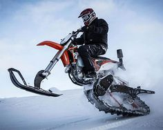 Mountain Horse Dirt Bike Snow Conversion Kit - Instead of buying two different gas-powered vehicles to pollute the forest air, the Mountain Horse Snow Bike kit lets you convert your dirt bike into a snowmobile, effectively giving you two vehicles in one, each perfectly suited to their respective season. | Werd