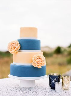 Sophisticated and modern, this peach and blue confection would look as terrific in an art museum event as it would in a chic rustic wedding. | Something Blue Wedding Cakes for a Fresh Take on a Classic Tradition