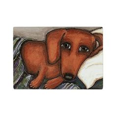 Dachshund on the pillow Glass Cutting Board on CafePress.com