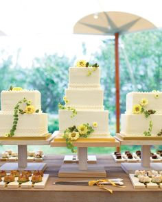 Guests dug into three square buttercream cakes -- one vanilla, one chocolate, and one marble to symbolize the new union. All three were made by One Girl Cookies had minimal piping and fresh blooms.