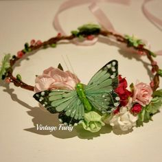 Welcome to Vintage Fairy This crown is my new favoong wire base. favourite I love the mix of pink and green.The flower cluster sits to the side with a pretty butterfly resting on a flower bed. Flowers  circle around the crown Pretty pink and green berries trwisted around a strong wire base.Ribbon ties up in the back and can extend the size of your crown.Made to fit newborns to adults Flower crown, foral crown, halo, hair wreath, wreath, headband, head...
