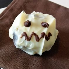 Spooky Cookie Truffles - A great kid-friendly treat for Halloween. Cookies, cream cheese and chocolate coating come together to create a fun sweet treat.