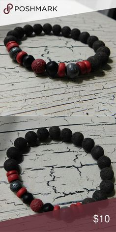 Black & Red Genuine Gemstone Stretch Bracelet BRAND NEW! Made with genuine gemstones! Only gemstones I can name are the red, thin, round beads: wooden beads and majority of black beads and middle red round bead: lava stones. This is a stretch bracelet! Price is firm. It's genuine gemstones at an incredible price! 7 inch circumference (unstretched) Accessories Jewelry