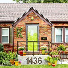 """I LOVE the giant house numbers, door color and """"hello"""" box! What an inviting house!!!!  How to Increase Curb Appeal on a Budget – Better Homes & Gardens – BHG.com"""