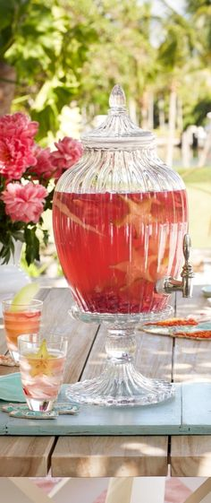 Crafted from molded and mouth-blown glass, this beautifully scalloped Charleston Beverage Dispenser brings charm and style to any table.