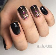 Lace up your nails in the most stylish way than ever, with this next nail art design that we have on our list. The combination of glossy white and black nail paints along with the matte glittered black makes the next amazing masterpiece worth trying.