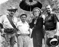 """Gilbert Roland, director George Sherman, Shelley Winters and producer Edmund Grainger between takes of """"The Treasure of Pancho Villa"""" (1955)"""