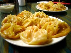 Kawa Mantisi, or Pumpkin Dumplings. A common dish throughout Central Asia, it is usually served steamed. In Kazakh and Kyrgyz cuisine, these dumplings often are topped with butter, sour cream, or hot red pepper powder