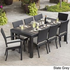 The Deco dining table seats up to eight adults with plush seating and vibrant colors to fit your outdoor space, featuring two chairs with arms and six without.