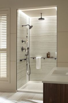 Marble-patterned walls, smart shower barres and a foldable seat are a few the features of the Choreograph shower system.