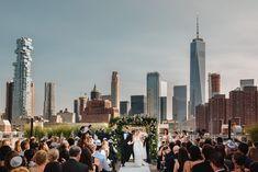 Bride and groom walk down the aisle. Wedding portraits. New York wedding. Rooftop wedding. Tribeca rooftop NYC