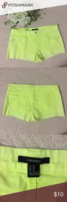 Neon yellow Forever 21 bootie studded shorts Bright shorts with silver pocket studs that are in excellent condition. 🚚fast shipping!🚚 if you have any questions comment below!! I'm open to negotiations 🤝 Forever 21 Shorts Jean Shorts