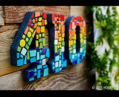 Idea from hobby Lobby. Wooden numbers with mosaic.