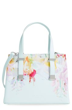 Adoring this shopper from Ted Baker! It features adjustable handles, two deep compartments, and logo-etched hardware to polish off the spacious faux-leather style.