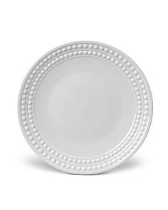 The refined beauty of natural pearls informed this elegant white porcelain dinnerware from L'Objet. Plate measures in diameter Limoges porcelain Dishwasher safe