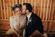 This Arizona desert wedding features two gorgeous vintage bridal gowns, thrifted reception décor, and foraged florals from the desert.