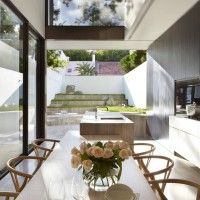 This exciting renovation and extension of a turn-of-the-century terrace house in Sydney's Potts Point focuses on a grand and gracefully spiralling stair that forms the pivotal junction of the old and new parts of the house.