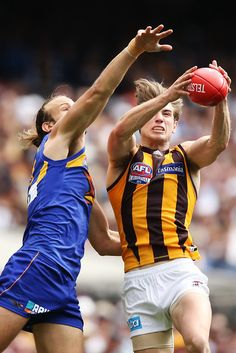 2015 Toyota AFL Grand Final - Hawthorn v West Coast - Ryan Schoenmakers of the Hawks marks the ball against Chris Masten of the Eagles during the 2015 Toyota AFL Grand Final match between the Hawthorn Hawks and the West Coast Eagles at the Melbourne Cricket Ground, Melbourne, Australia on October 3, 2015.
