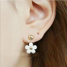 2 in 1 Earrings These cute white flower earrings can be worn with or without the flower. Zinc alloy metal. New in package. Jewelry Earrings