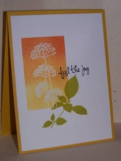 stamped & embossed image...sponging over image in orange/yellow ombre...pleasing design...
