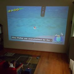 Curious one by killinemnc #retrogaming #microhobbit (o) http://ift.tt/1LIaV71 thought I was going to play some old school mario with my new projector....went to the fridge came back.....my son done got me!