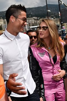 Real Madrid footballer Cristiano Ronaldo and Cara Delevingne at the McLaren Honda Garage in the Pitlane Before the Monaco Formula One Grand Prix at Circuit de Monaco, May 2015