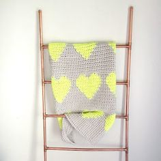 I'm not usually a heart person. It's not my style. But my multi hearts blanket is too sweet not to love. And HELLO neons and neutrals?! #tha...