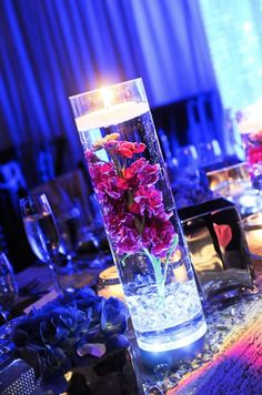 Glowing Wedding Centerpiece: Simply adding a glow cube to your floating wedding flowers can make a huge difference! These little cubes are plastic and battery-operated. Turn them on and put them at the bottom of the vase for a truly beautiful display.