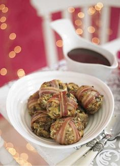 Pork, sage and chestnut stuffing parcels - The best recipe for stuffing. These little bite-sized parcels use vacuum-packed chestnuts, which give a gorgeous festive touch. Wrapped in bacon they look good and taste good too. Make plenty to go alongside your Christmas dinner.