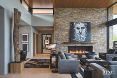 This contemporary stone living room makes it easy to curl up by the fireplace.