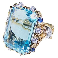 STERLE Aquamarine Ring  France  Circa 1950  An aquamarine (approx 15ct), sapphire and diamond cocktail ring by Sterle. Mounted in 18ct yellow gold and platinum.