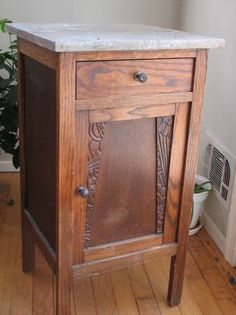 """marble-topped art deco night stand table with drawer and door. The Craigslist owner said """"This was from a store in Del Ray. Perfect for our house there."""""""