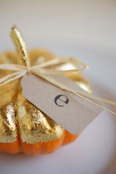 Thanksgiving or Halloween These mini pumpkins are half painted in gold paint -- use them as a place card setting for an elegant way to decorate a dinner party. Thanksgiving Table, Thanksgiving Decorations, Fall Table, Holiday Crafts, Holiday Fun, Diy Pumpkin, Gold Pumpkin, Pumpkin Carving, Pumpkin Decorating
