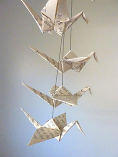 I want a paper crane mobile for the nursery one day. :)