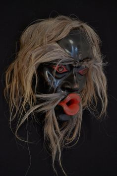 """Beau Dick - Tsonaqua Mask. Red cedar, acrylic paint, horse hair. 13"""" x 11"""" x 9"""" Fazakas Gallery is a Vancouver Art Gallery with exciting works from Contemporary Artists from diverse backgrounds and cultures.  www.fazakasgallery.com"""