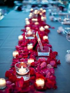 Rose petals as table runners between the lantern/ flower pots/ birdcages....