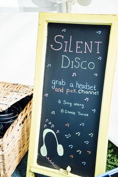 FESTIVAL BRIDES | A Festival Inspired Colourful Outdoor Wedding with Glamping - silent disco wedding signage