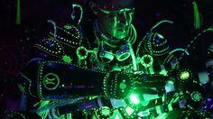 TechnI Shaman Enki performing a sacred maintenance ritual on the Gateway Staff. #shaman #futureprimitive #glow #glowinthedark #facepaint #technoshaman #annunnaki #enki #costume #cosplay #uv #green #uvreactive #photoluminescent #fluorescent #blacklightreactive #blacklight #led #art #craft #burningman