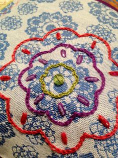 Posy on pillow. Original design by Linda Sweek