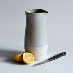 "Wheel-thrown ""Penguin Pitcher"" from potter Bob Dinetz. Light grey glaze over a stone-colored clay. Doubles as a vase. $88."