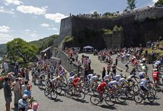 """A pack of riders cycle past the citadel of Namur during the second stage of the 99th Tour de France cycling race between Vise and Tournai, July 2, 2012. REUTERS/Stephane Mahe"" #letour #TdF #cycling"