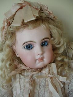 Grays Antique Centre A delightful EJ 9 measuring 20 inches Good pale bisque with light blue paperweight eyes and wearing old pink very fine lawn, silk and ecru lace She has her 8 ball jointed body with blue jumeau mark SALE PENDING