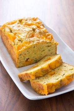 Savory Zucchini Bread.  If you can surprise people by putting zucchini into a sweet bread, why not put it into a savory bread?  When it comes out of the oven, the cheese on top forms a crispy golden crust of browned cheese, while the cheesy chunks in the center leave hollow pockets in the bread, melted and gooey.  You could even add crumbled sausage or bacon to this recipe and serve it at a brunch.