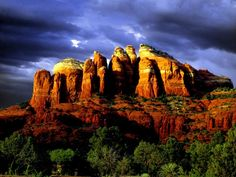 The breathtaking Red Rocks of Sedona are a group of several limestone rock formations located near the city of Sedona in Arizona, United States. The rocks are known for the incredibly vibrant red and orange glow they exhibit when illuminated at sunrise and sunset.