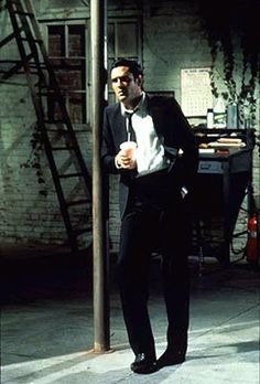 Michael Madsen as Mr. Blonde in Reservoir Dogs, Song that will forever be in my head - Stuck in the middle with you.