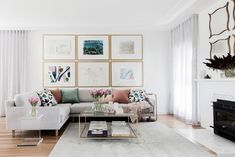 Identical frames in this living room turn diverse works of art into a cohesive collection. | Photo: Maree Homer | Story: Australian House & Garden