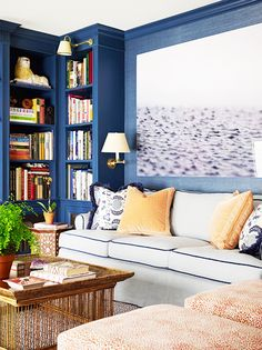Throwback Decor Trends We Still Secretly Love// blue library, large scale photography, two color rooms, built in bookcases