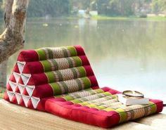 Thai style triangle pillows for a more comfortable low table seating arrangement?
