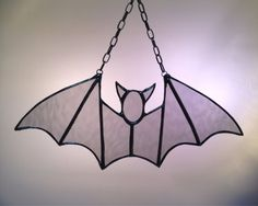 Hey, I found this really awesome Etsy listing at https://www.etsy.com/listing/203466562/stained-glass-halloween-bat-suncatcher
